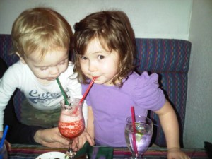 Our grandchildren enjoying a fresh strawberry margarita!